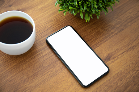 touch phone with an isolated screen is on the table in the office Фото со стока
