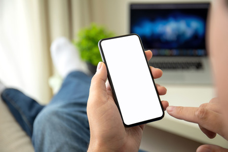 male hands holding phone with isolated screen in a room in the house