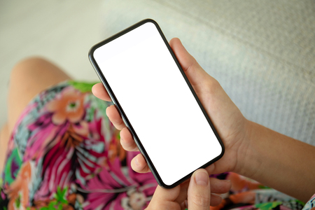 female hands in colored dress holding phone with isolated screen Фото со стока
