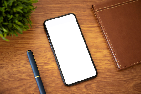 touch phone with Isolated screen on a yellow office table Фото со стока
