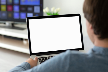 man holding laptop with isolated screen in the house in the room