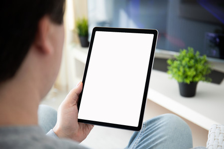 man hands holding computer tablet with isolated screen in the home room Stockfoto