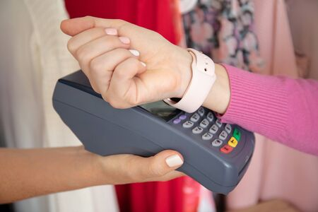 Woman payment purchase for watch and pay pass online terminal at a store