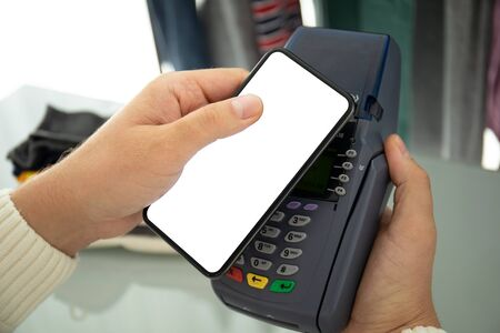 Man payment purchase for phone with isolated screen and pay pass online terminal in the store