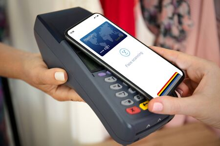 Woman payment purchase for phone with face scanning id and payment purchase on pay pass online terminal