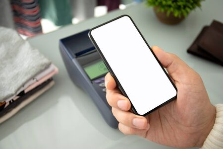 Man payment purchase for phone and pay pass online terminal in the store