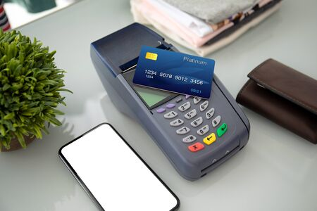 Plastic card payment purchase and pay pass online terminal and phone with an isolated screen Imagens