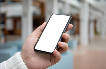 male hand holds phone with isolated screen on the street
