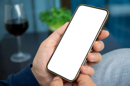 male hand holding golden phone with isolated screen background room in house