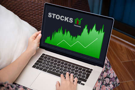 female hands on keyboard computer laptop with IPO stocks purchase app on screen Stockfoto