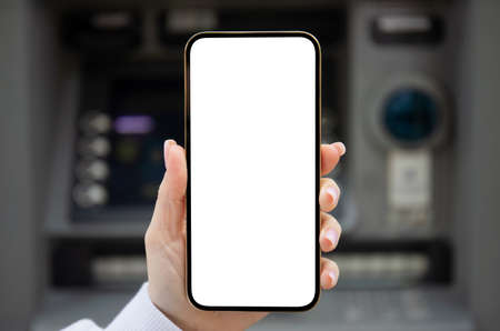 female hand holding phone with isolated screen on ATM background