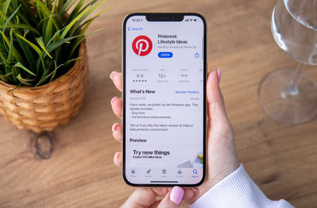 Alanya, Turkey - February 25, 2021: Woman hand holding iPhone 12 Pro Max Gold with app Pinterest in the screen. iPhone was created and developed by the Apple inc. Redactioneel