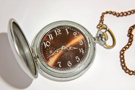 Antique mechanical pocket watch photo