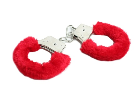 Red sexual handcuffs sexshop Stock Photo - 13409266