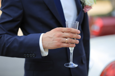 luxuriously: A man with a glass
