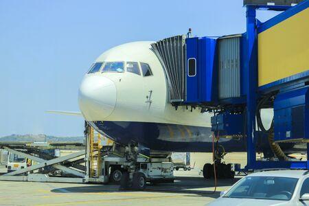 Passenger plane at the airport passenger boarding Banco de Imagens