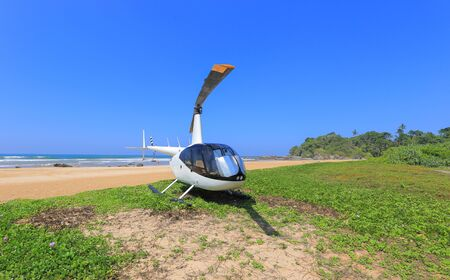 White helicopter on the beach