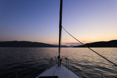 Sailing yacht after sunset, bow yacht