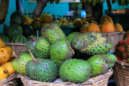 Fresh soursop fruit in the market close up