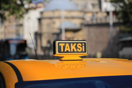 Yellow taxi car roof sign in Turkey