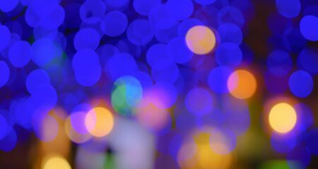 Abstract blur city night club blue green yellow white purple bokeh light background. Horizontal defocused image, copy space.