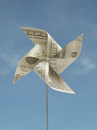 Hand-made windmill toy cut out from one hundred usd banknote 1007_09 Stock Photo