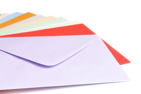 Array of empty envelopes in various colors over white background Stock Photo
