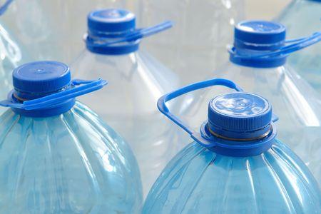 Closeup of empty plastic drinking water bottles photo