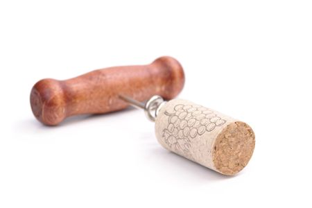 Wooden handle cork screw with driven wine cork over white background