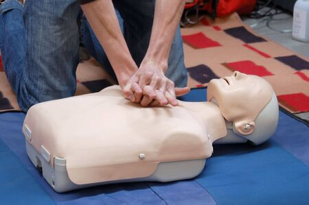 cpr: Resustitation training using first-aid dummy Stock Photo