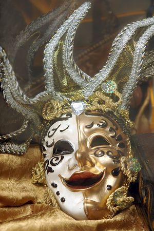 placed: Venetian mask placed on golden fabric Stock Photo