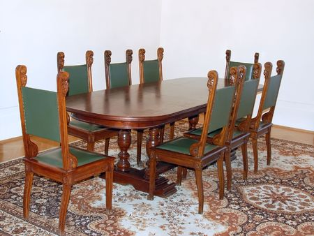 Conference room with stylish wooden oval table and leather upholstery chairs photo