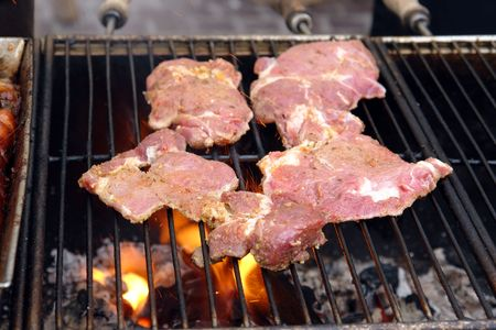 Red meat chops put on the barbecue set on fire Stock Photo - 1091537