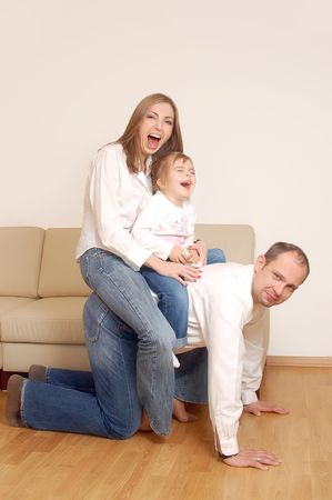 Young happy married couple with little cute daugther having good time together Stock Photo - 1341506