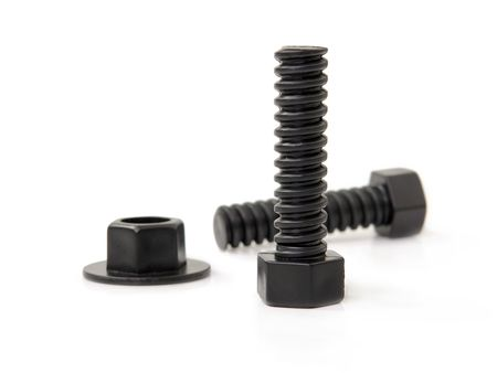 Black bolts and nut over white background photo