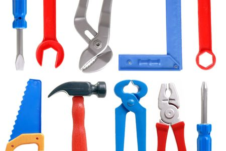Set of plastic toy tools over white background