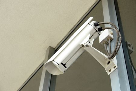 close circuit camera: Security cctv camera fixed to office window frame