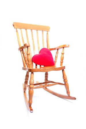 Stock Photo   Wooden Rocking Chair With Red Heart Shaped Pillow Over White  Background
