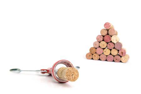 corked: Cork screw and wine cork pyramid over white background