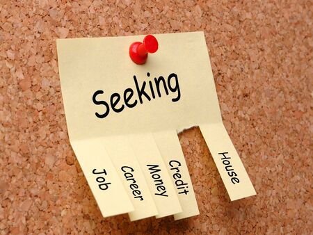 affixed: Yellow post-it note with job, career, money, credit, house seeking ad, affixed to the corkboard with red pushpin