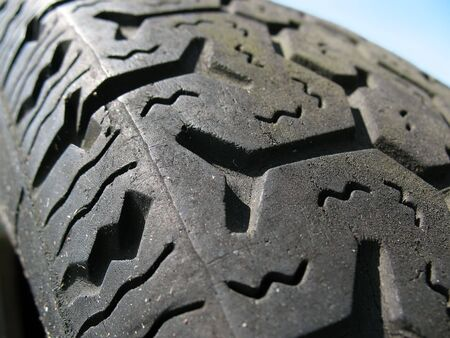 cloesup: Extreme closeup of used car tire tread