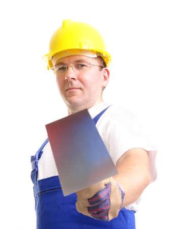 overall: Trabajador de la construcci�n general de uniforme azul y amarillo casco de acero inoxidable celebraci�n paleta m�s de fondo blanco