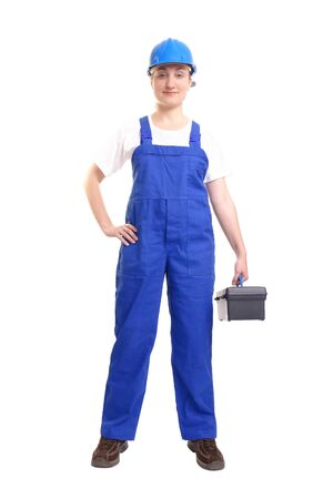 servicewoman: Service woman wearing blue helmet and overall holding black toolbox over white