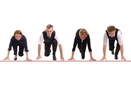 Four business people lined up getting ready for corporate race - rat race concept