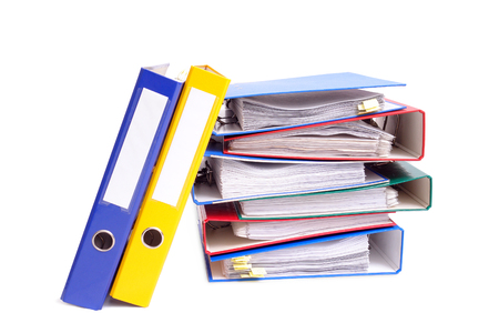 Pile of colorful ring binders over white background photo