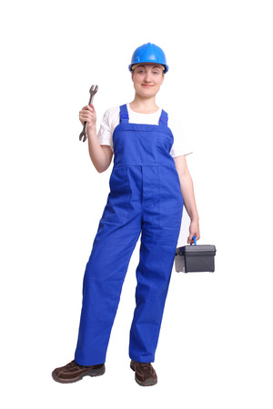 Servicewoman wearing blue helmet and overall holding black toolbox in one hand and flat wrench in another hand over white background photo