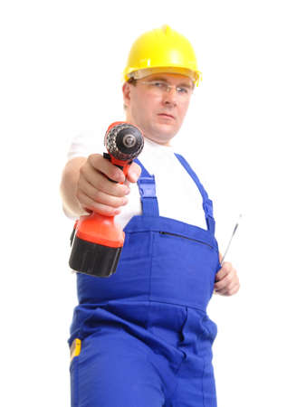 driller: Construction worker wearing blue overall and yellow helmet pointing with drilling machine over white background