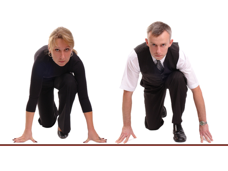 contender: Businessman and businesswoman lined up getting ready for corporate race - rat race concept Stock Photo