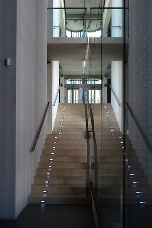 Modern office staircase with illuminated steps photo