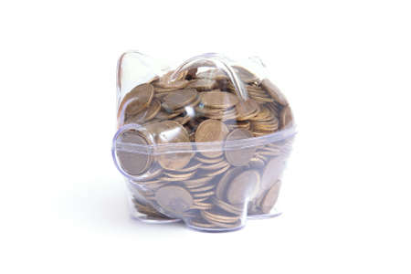 Transparent piggybank full of Polish one grosz coins over white background photo